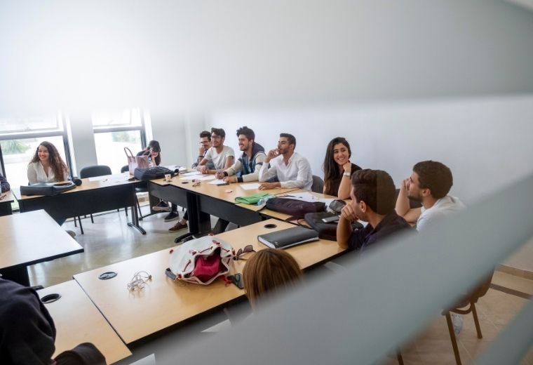 Students in a classroom at the University of Tunis Carthage studying english courses